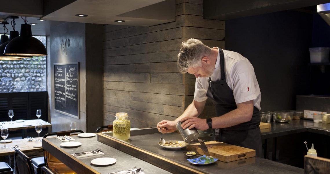 Chef Michael Bremner at the pass at 64 Degrees
