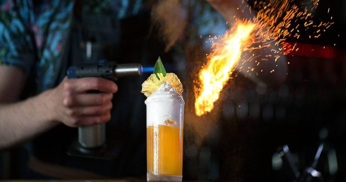 Picture of Julien serving a cocktail from GungHo