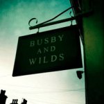 Busby and Wilds sign