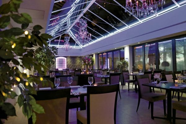 The Glass House restaurant at night