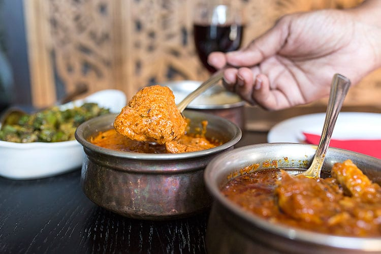 Chaula's Lewes - Serving creamy curry at Chaula's Lewes