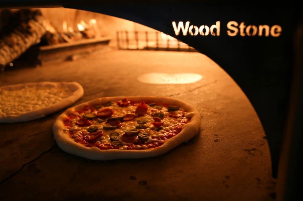 Pizza in oven. Al Duomo Italian Restaurant