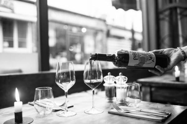 Wine pouring at Grow 40 Brighton