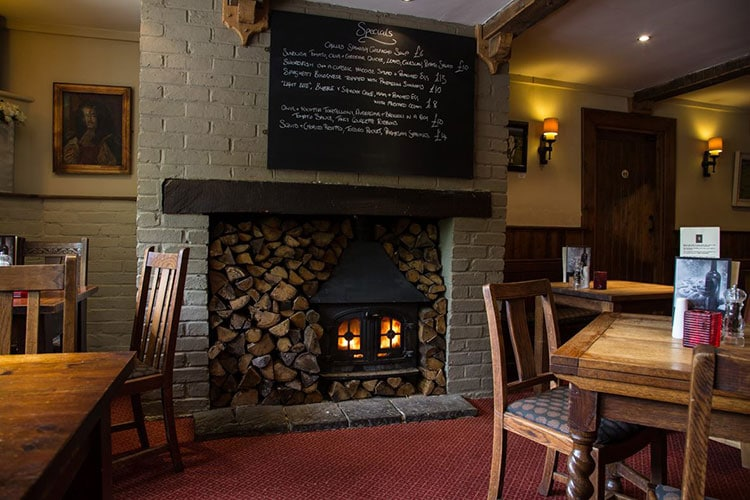 pubs with fires, the fire with logs at Sussex pub