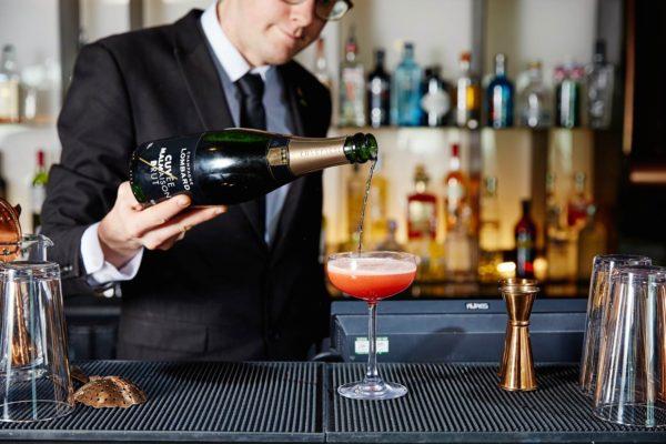 pouring champagne at Malmaison, Brighton Marina