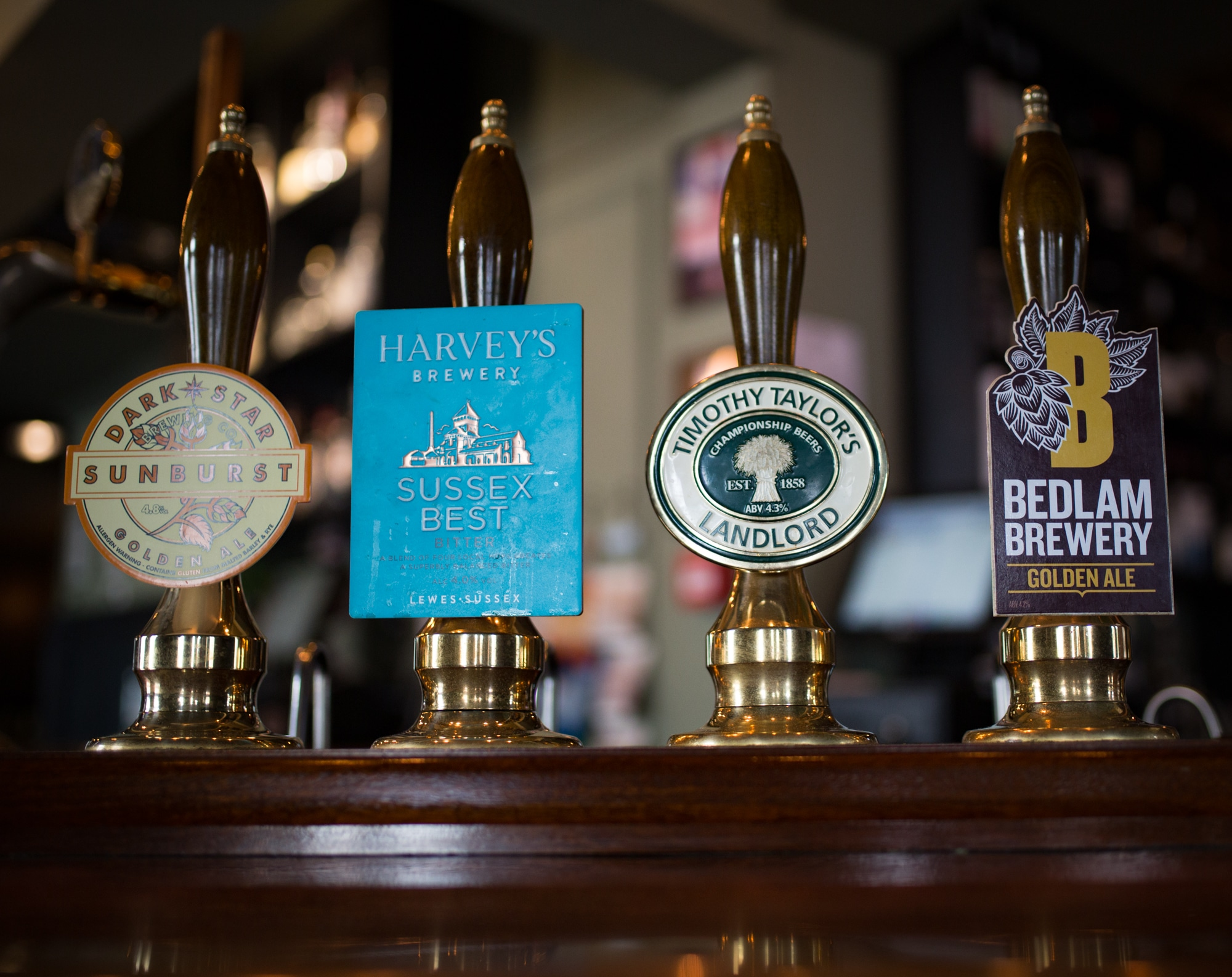 Beer taps at the Better Halh pub in Hove