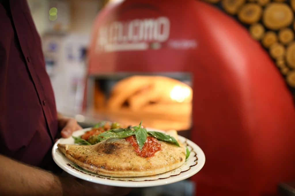 The classic Calzone pizza at Al Duomo in front of their pizza oven