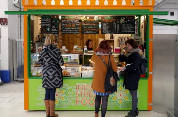Kiosk at Brighton station serving takeaway food by Curry Leaf Cafe