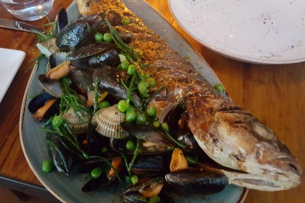 Whole seabass at the salt room