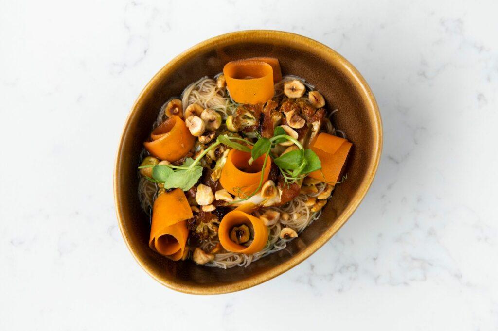 bowl with carrots cut in thin rolls, hazel,