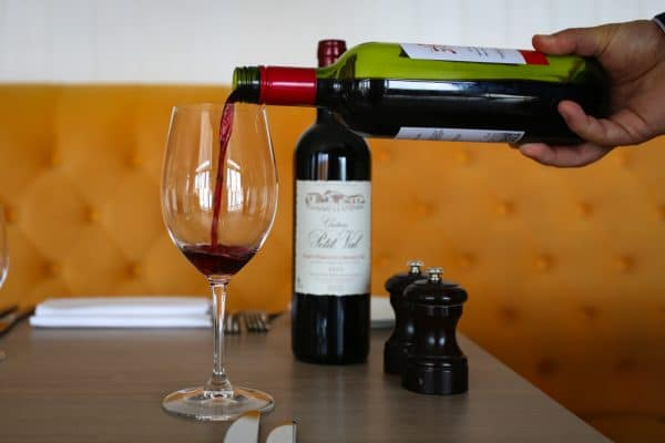 Pouring red wine - The Jetty Restaurant
