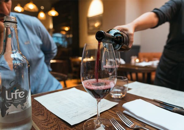 Wine being poured at The Coal Shed restaurant Brighton