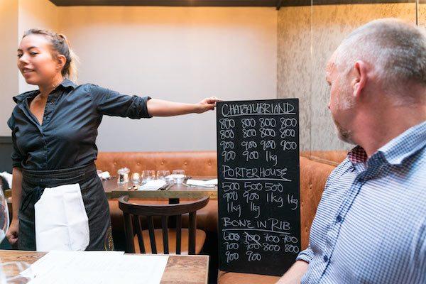 Chalk board steak menu at the coal shed restaurant in Brighton