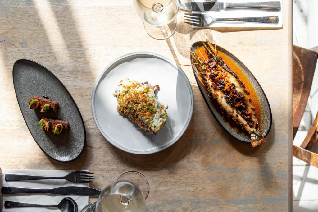three seafood dishes on the table