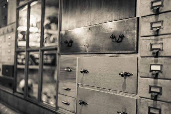 Wall of drawers at Libation, Hove