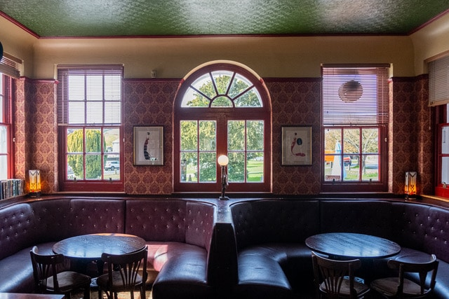 Inside of a pub with red walls