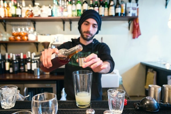 mixing cocktails at polpo restaurant