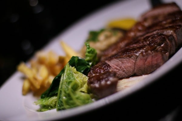 Strip steak with buttered greens and truffle parmesan fries