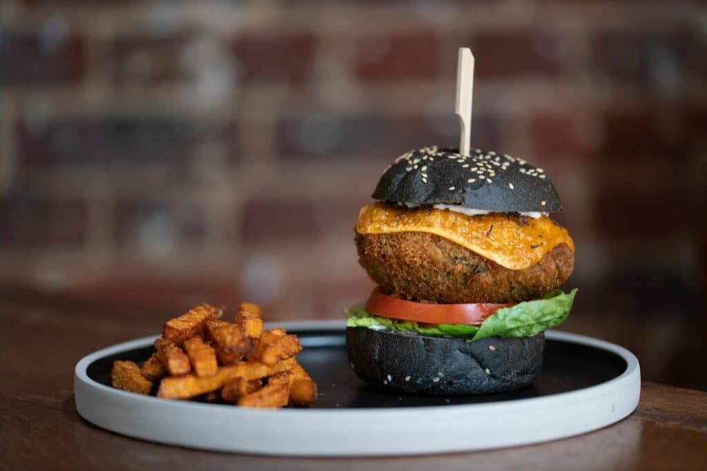 black bun burger with potato chips