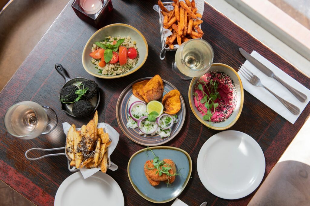 Table laid out for two with four dishes and sides