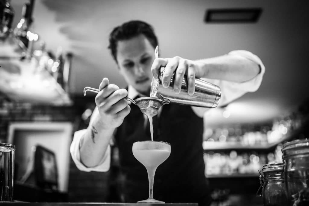 Hotel Restaurants, Straining into a cocktail glass - Social Media Marketing Brighton