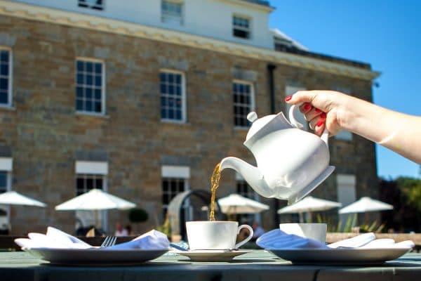 Pouring tea at Proud House Brighton