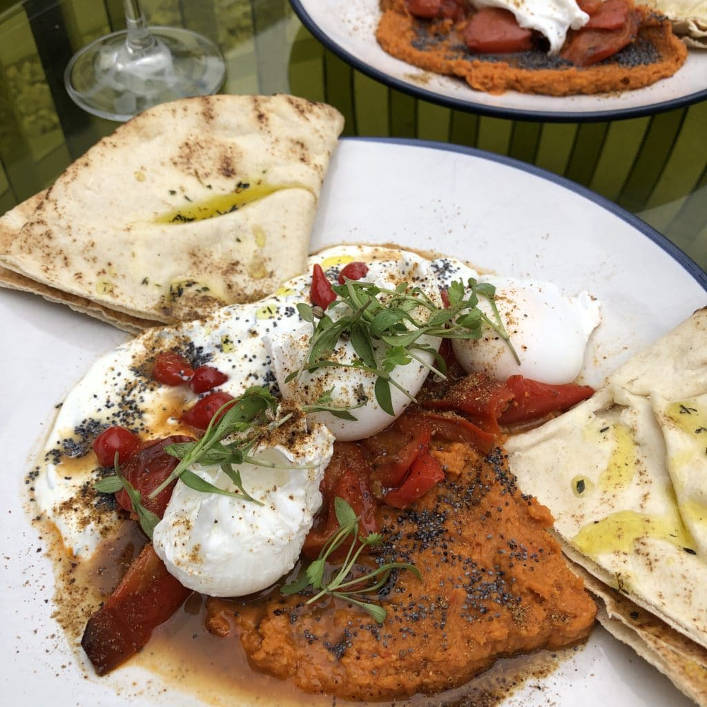 close up of poached eggs and flat breads