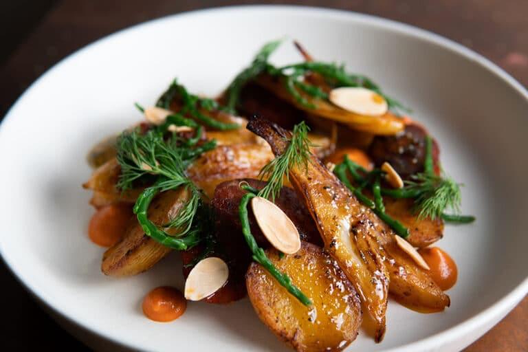 Pan roasted chorizo, new potatoes, orange braised fennel, romesco, almonds, samphire.