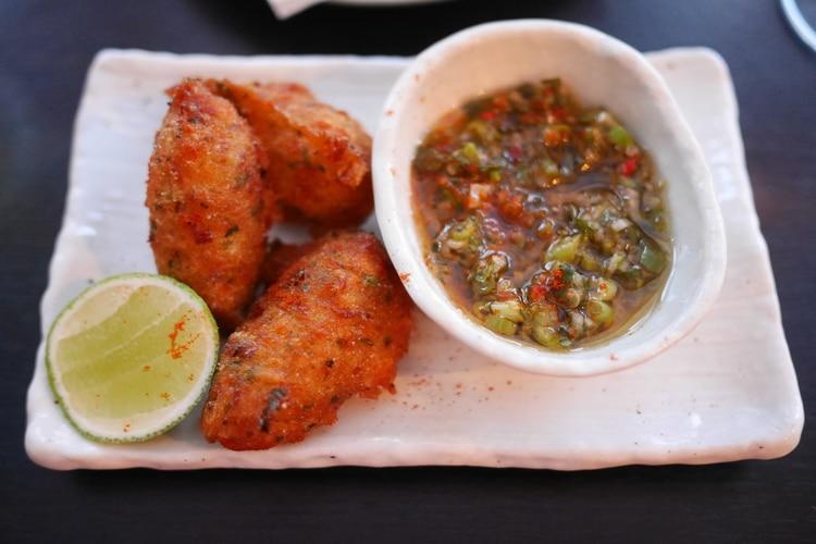 Salt fish fritters at petit pois
