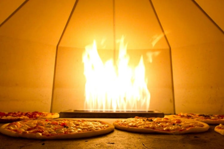 Pizzas in an oven at PizzaFace, credit Pizzaface Facebook - Worthing Restaurants