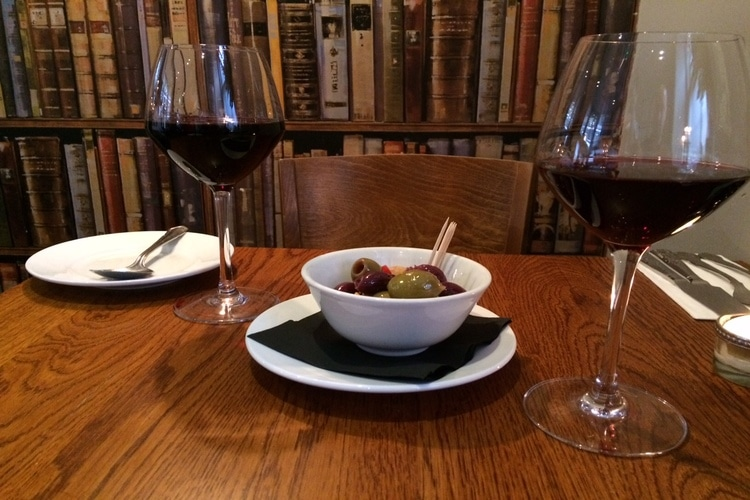 olives and wine to start at the house restaurant, brighton