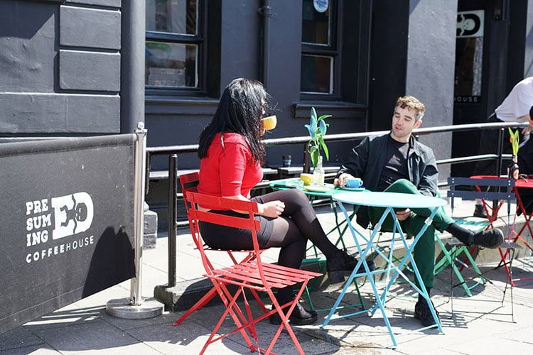 Cafés & Coffee Shops with Wi-Fi, drinking coffee outside Presuming Ed's cafe on London Road