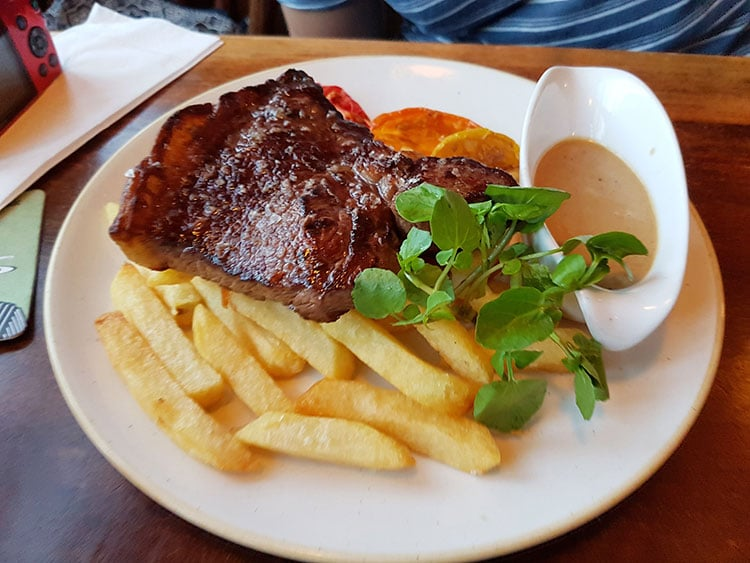 Steak with a blue cheese sauce and chips at The Plough Inn