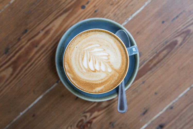 Cup of coffee at with latte art at Starfish and Coffee cafe
