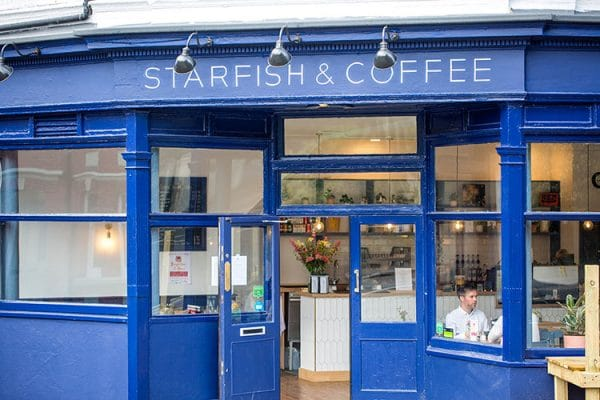 Outside at Starfish and Coffee cafe in Brighton near Queen's Park