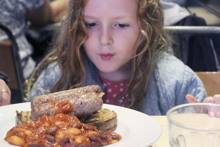 Girl having breakfast at V&H cafe