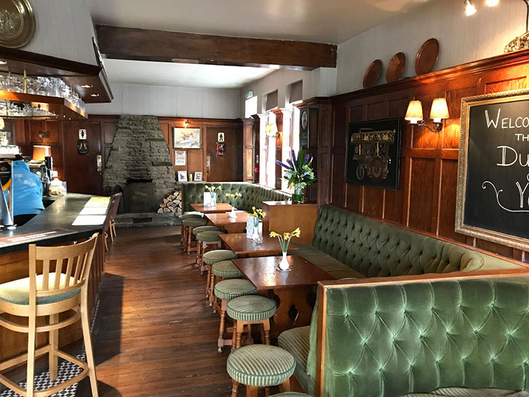 Christmas Parties Brighton, Pubs with fires, chairs and tables inside Sussex pub