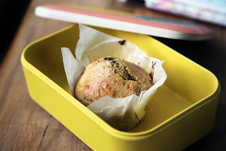 Packed lunches, muffin in a yellow lunch box