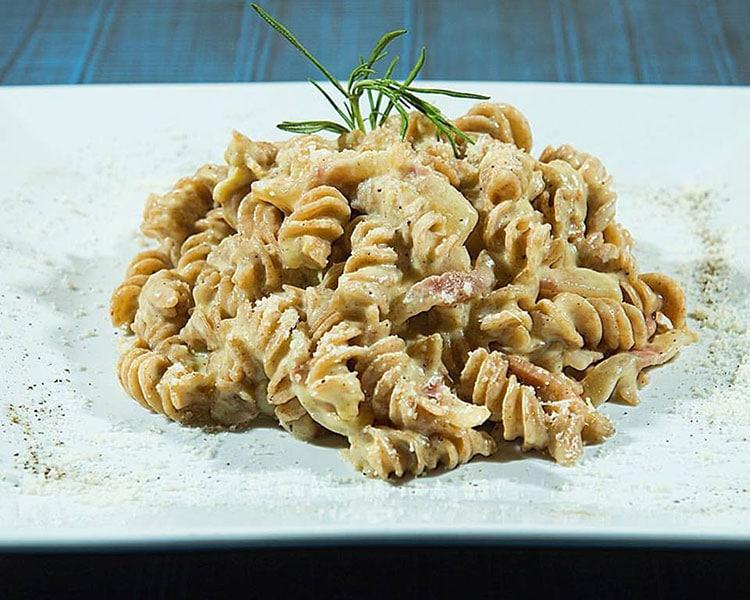 creamy pasta with rosemary garnish at Hove restaurant, Semola Restaurant Hove