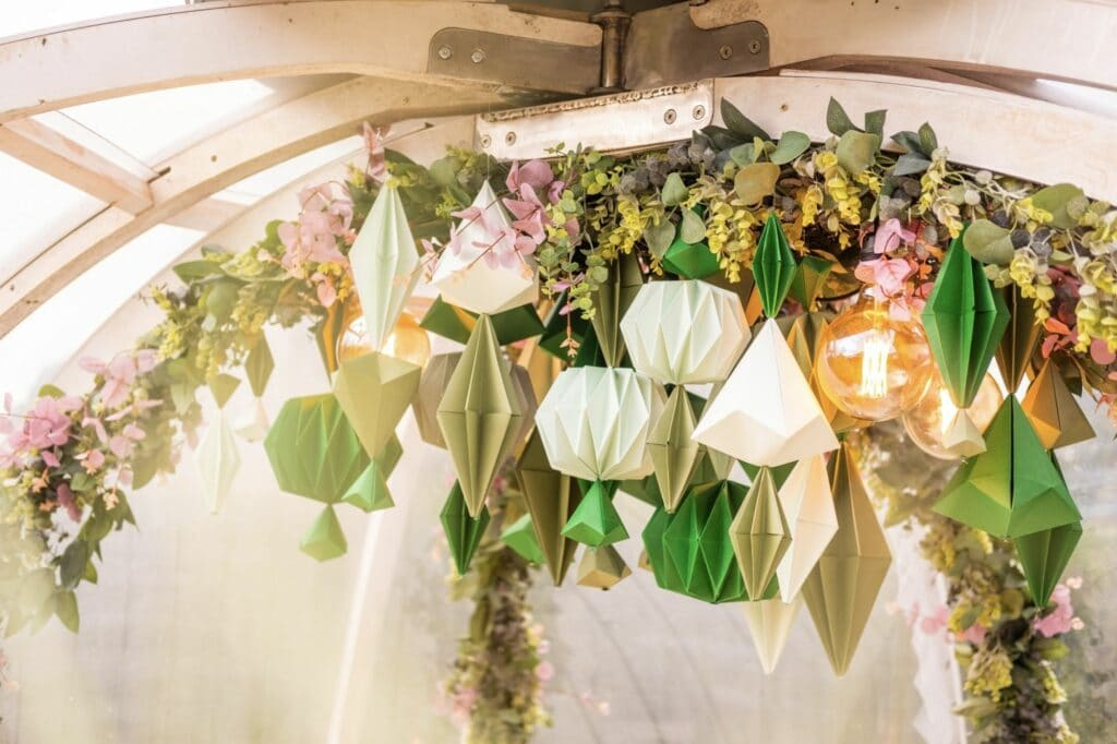 Autumn igloo installation at The Coppa Club, a hanging arrangement of paper sculptures and foliage