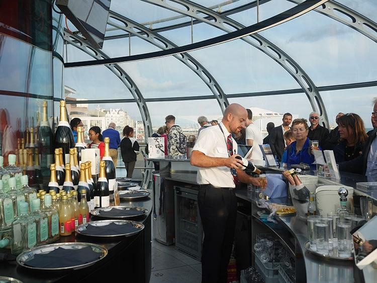 Bar and people inside the BAi360 - Brighton i360