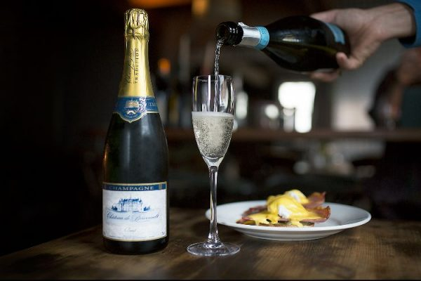 Champagne and eggs Benedict at Grow 40
