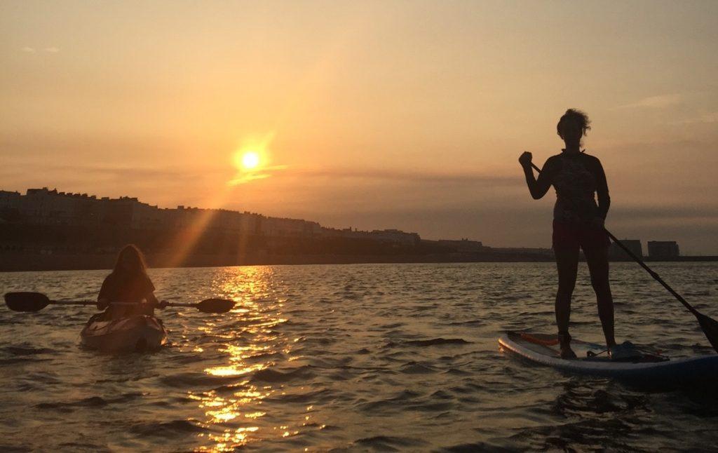 Paddle boarding at sun rise - Brighton