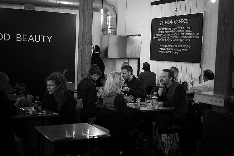 vegan review, people eating at Brighton restaurant. Food trends 2018
