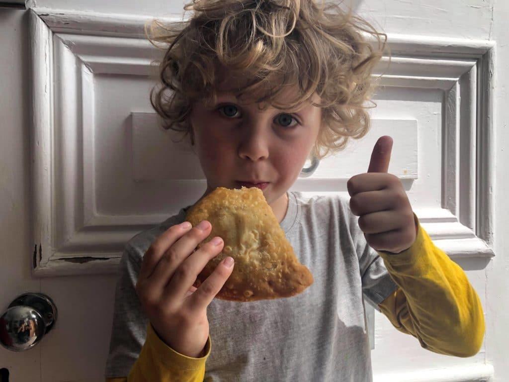 Boy with a samosa