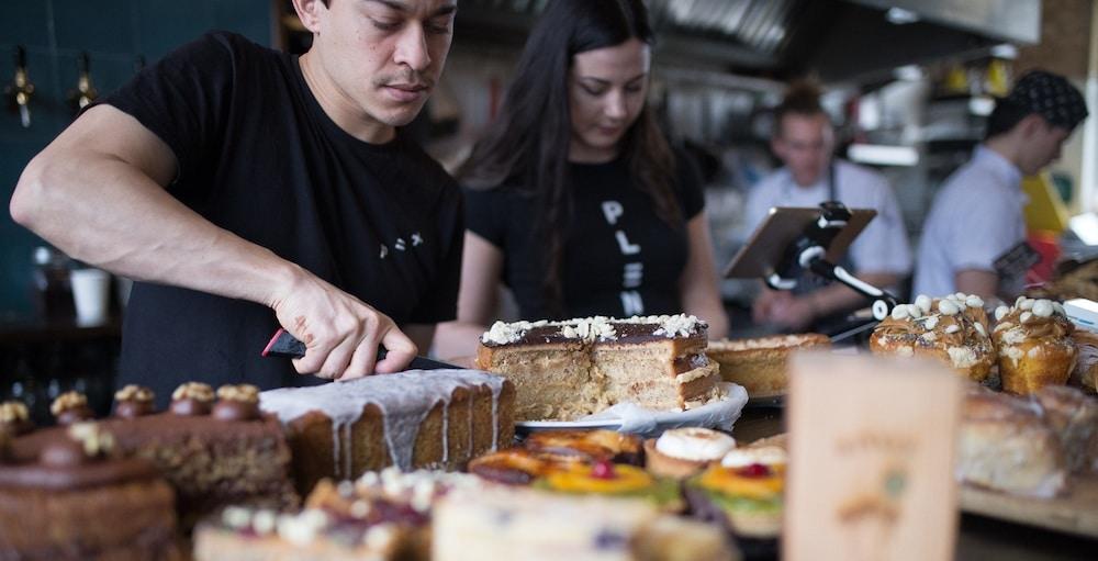 Staff and cake at Cafe Plenty