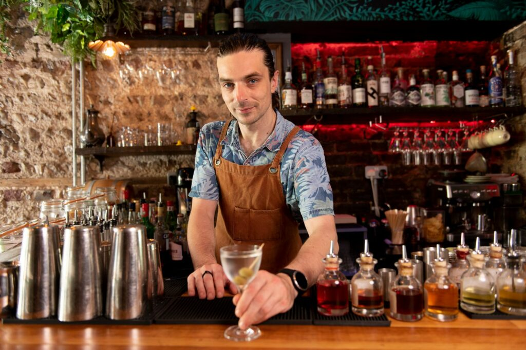 gungho bartender with cocktail in hand