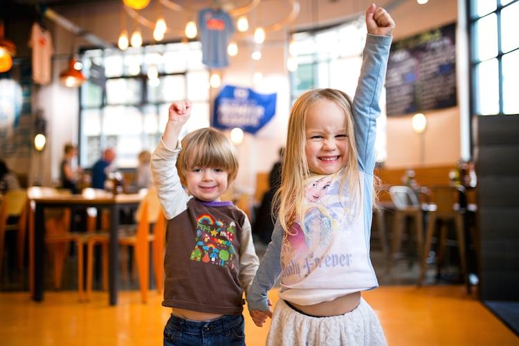 Kids cheering inside Italian restaurant Nuposto