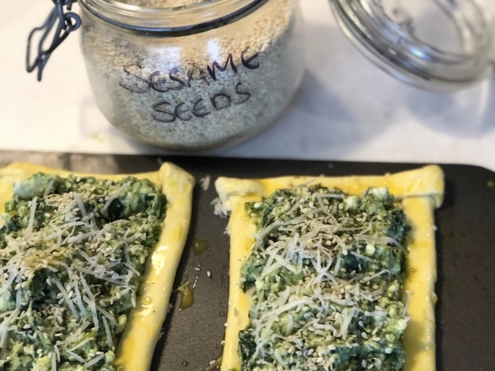 Three-cornered leek pesto, feta and spinach tarts