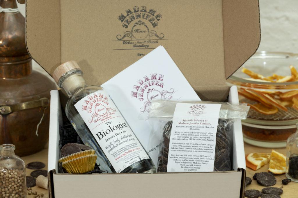 Boozy truffle DIY kit, a bottle of spirits some chocolates, chocolate cases and instructions on how to make truffles in a presentation box